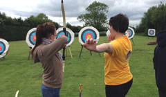 Archery Coach showing a student